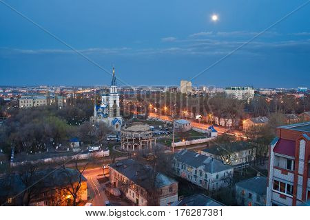 Moonlight evening Voronezh from rooftop. View to memorial of destroyed and Rotunda and Church of Equal to the Apostles Vladimir.