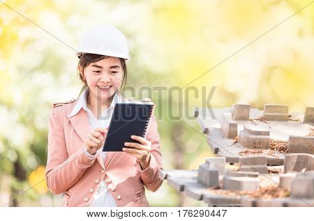 executive Asian engineer woman checking construction site business environment engineer concept