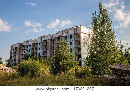 Abandoned five-story house, summer, Russia, Samara region
