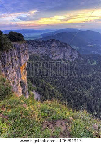 Creux-du-Van or Creux du Van rocky cirque at sunrise, Neuchatel canton, Switzerland