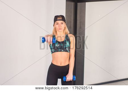Sexy Young Athletics Girl Doing Dumbbells Press Exercises. Fitness Muscled Woman In Black Sport Clot