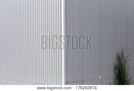 Beauty in the geometry of the structure of modern Wall of corrugated metal. Perspective up. Long thin lines. Elegant design.
