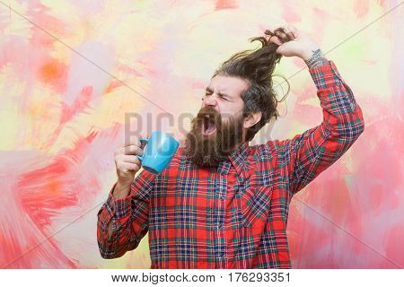 Crying Bearded Man Pulling Stylish Fringe Hair With Blue Cup