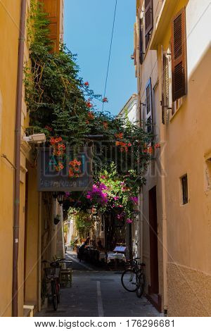 Rethymno, Greece - August  3, 2016: Narrow Venetian Street In Old Town.