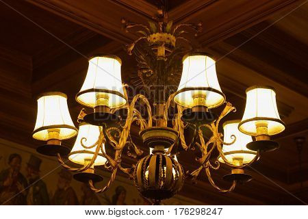 The old charming chandelier at night close up