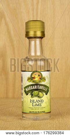 RIVER FALLS,WISCONSIN-MARCH 11,2017: A bottle of Margaritaville brand Island Lime liqueur with a wood background.