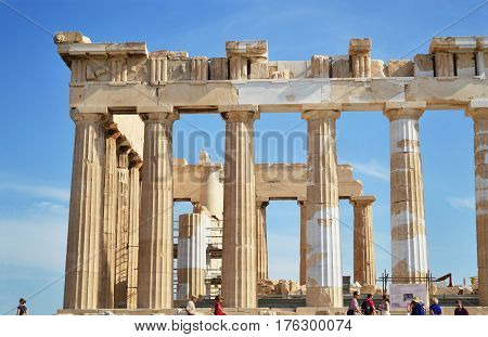 ACROPOLIS ATHENS GREECE, MAY 18 2015: the ancient columns of the Parthenon Acropolis Greece with tourists. Editorial use.