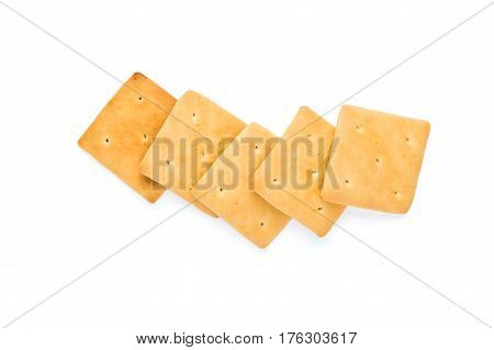 healthy breakfast crackers lined up in a row isolated on white background
