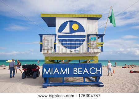 USA, FLORIDA, MIAMI BEACH. MARCH 10, 2017. Lifeguard tower in a colorful Art Deco style, with blue sky and Atlantic Ocean in the background. World famous travel location. South Beach.
