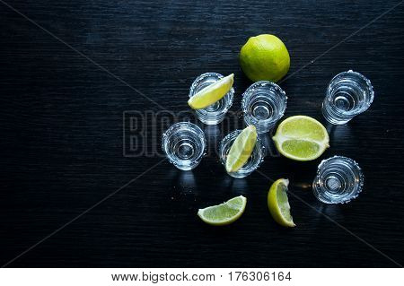 One Silver tequila shots with lime - Traditional Mexican drink