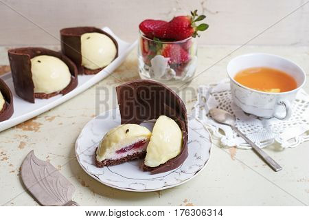 Chocolate souffle cake on a dish. Selective focus wooden background.