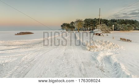 Frozen and snow-covered Kaunas lagoon in the middle of winter
