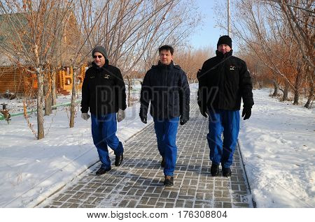 BAIKONUR, KAZAKHSTAN - DECEMBER 15, 2011: Expedition 31 crew (L-R: Don Pettit, Oleg Kononenko, Andre Kuipers) take a stroll down the Walk of Cosmonauts