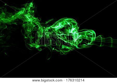 Green Colored Smoke On A Black Background.