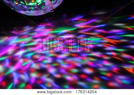 Light show on the floor/ Colourful lights on the floor.