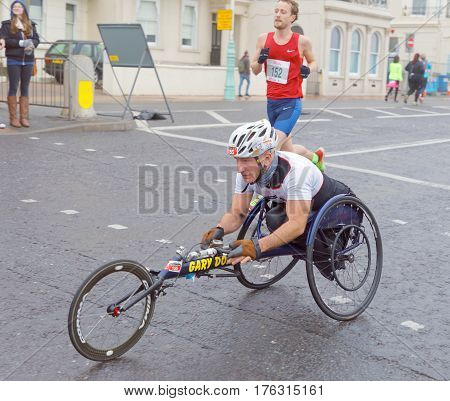 BRIGHTON GREAT BRITAIN - FEB 26 2017: Man i sports wheelchair in the Vitality Brighton half marathon competition. February 26 2017 in Brighton Great Britain