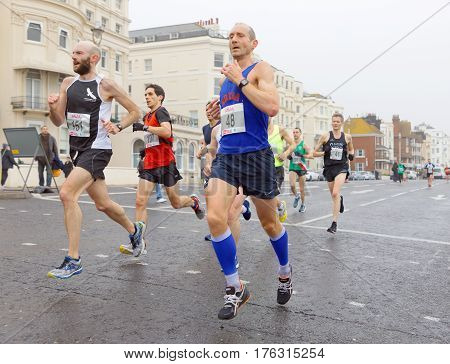 BRIGHTON GREAT BRITAIN - FEB 26 2017: Group of men running in the Vitality Brighton half marathon competition. February 26 2017 in Brighton Great Britain