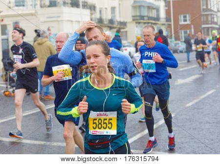BRIGHTON GREAT BRITAIN - FEB 26 2017: Woman and competitors r running in the Vitality Brighton half marathon competition. February 26 2017 in Brighton Great Britain