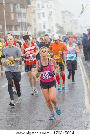 BRIGHTON GREAT BRITAIN - FEB 26 2017: Lots of runners in the Vitality Brighton half marathon competition. February 26 2017 in Brighton Great Britain