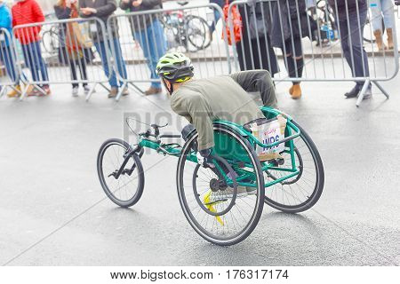 BRIGHTON GREAT BRITAIN - FEB 26 2017: Rear view of a man i sports wheelchair in the Vitality Brighton half marathon competition. February 26 2017 in Brighton Great Britain