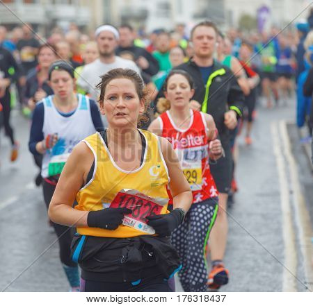 BRIGHTON GREAT BRITAIN - FEB 26 2017: Woman and competitors running in the Vitality Brighton half marathon competition. February 26 2017 in Brighton Great Britain