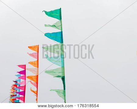 BRIGHTON GREAT BRITAIN - FEB 26 2017: Flags in green orange and red colors in the Vitality Brighton half marathon competition. February 26 2017 in Brighton Great Britain