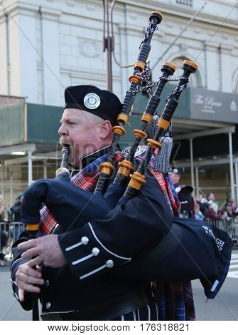 NEW YORK - MARCH 17, 2016: Wantagh American Legion Pipe Band marching at the St. Patrick's Day Parade in New York.