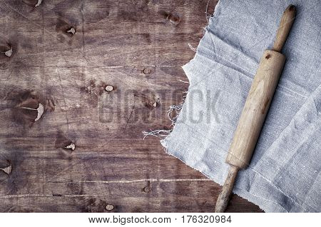 wooden kitchen roll on a brown surface an empty space