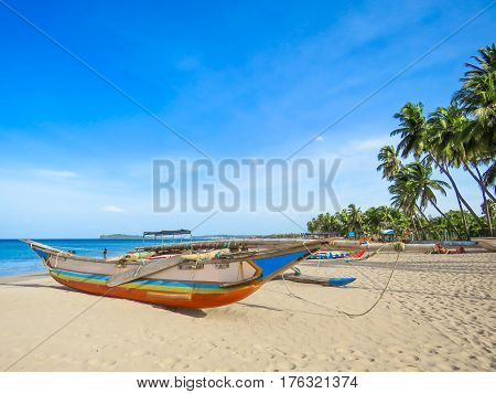 Catamaran on the White Sand Beach in Nilaveli, Sri Lanka