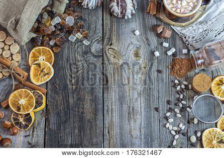Brown sugar candy and a cup with a drink on an old wooden surface free space in the middle