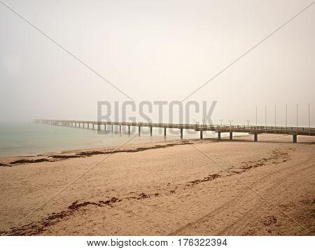 Autumn Misty Morning On Wooden Pier Above Sea. Depression, Dark  Atmosphere. Touristic Mole, Wet Woo