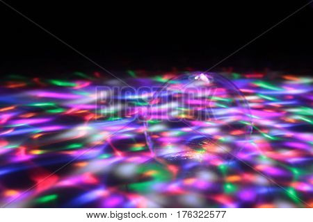 Bubble in light show on the floor/ Colourful lights on the floor with bubble.