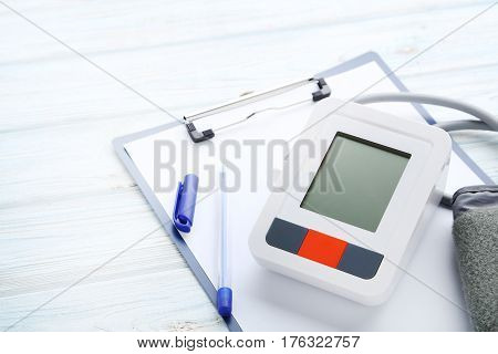 White electric tonometer on the wooden table