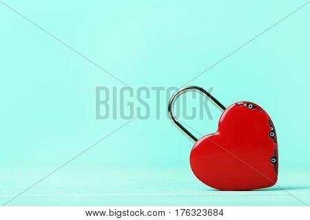 Heart shaped padlock on the green background