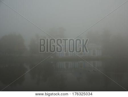 The mist over the water in the Catherine Park in Tsarskoye Selo