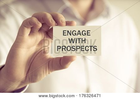 Businessman Holding Engage With Prospects Message Card