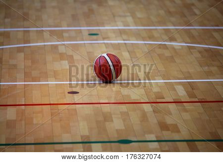 basketball in the basketball court with a wooden parquet