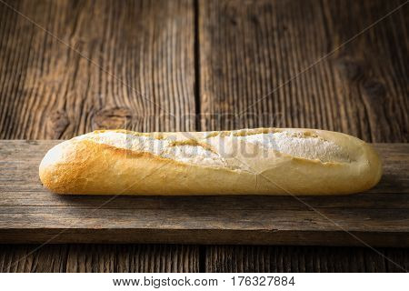 Freshly Baked White Baguette On A Wooden Background
