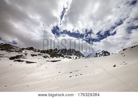 Snow mountain and cloud sky in gray spring day. Turkey Kachkar Mountains highest part of Pontic Mountains. Wide angle view.