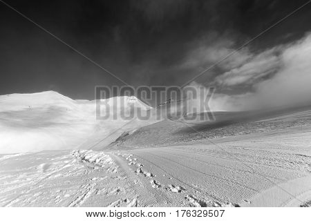Black And White View On Ski Slope With Footprints