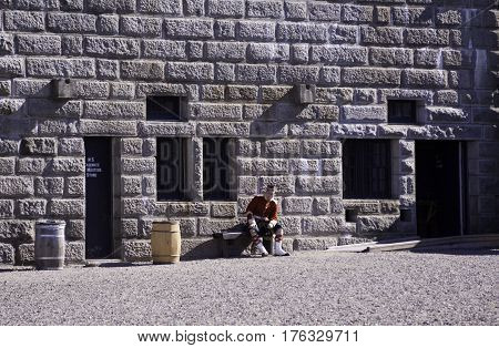 Halifax, Nova Scotia, September 23, 2015 -- A single Highland guard takes a break at the Citadel in Halifax Nova Scotia on a bright sunny day in September