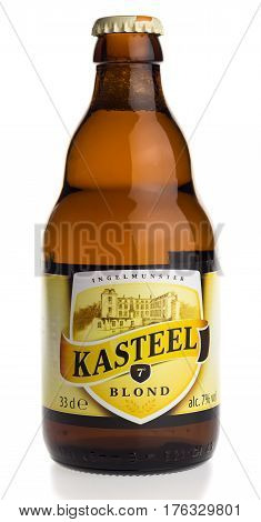 GRONINGEN, NETHERLANDS - MARCH 14, 2017: Bottle of Belgian Kasteel Blond beer isolated on a white background