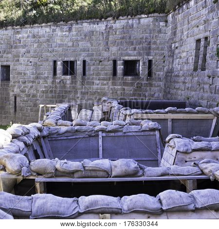 Halifax, Nova Scotia, September 23, 2015 -- A guide dressed in a First World War uniform stands among the sandbags and walls in the citadel at Halifax, Nova Scotia bright sunny day in September