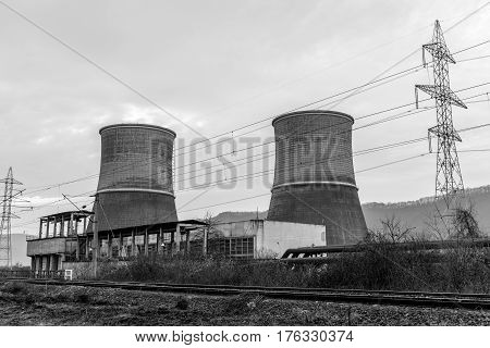 Black and white view of the Cooling towers of thermal power plant near the railway