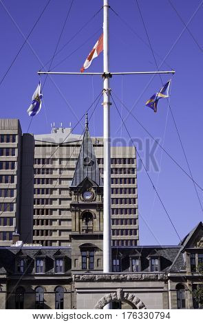 Halifax, Nova Scotia, September 23, 2015 -- Vertical of the flags blowing in the wind in front of the Halifax City Hall in downtown Halifax Nova Scotia on a bright sunny day in September