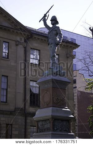 Halifax, Nova Scotia, September 23, 2015 -- Bronze statue depicting a soldier from the south African campaign in the late 1800s on a bright sunny day in downtown Halifax Nova Scotia