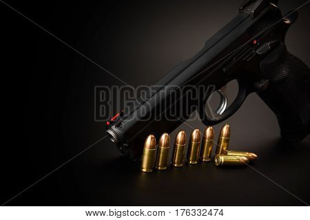 Pistol sig sauer on a black background with bullet