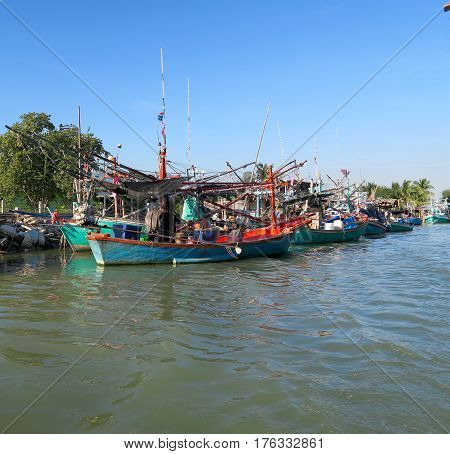 Fishing boats and sailing boats in a row Thailand