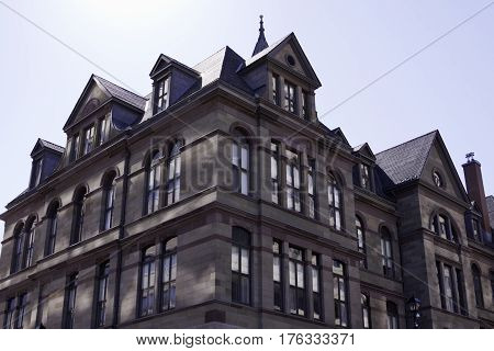 Corner perspective view of a large condo building in downtown Halifax, Nova Scotia on a bright sunny day in September