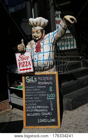 NEW YORK - May 14, 2015: Menu in front of restaurant in Little Italy, Lower Manhattan. Little Italy is an Italian community in Manhattan